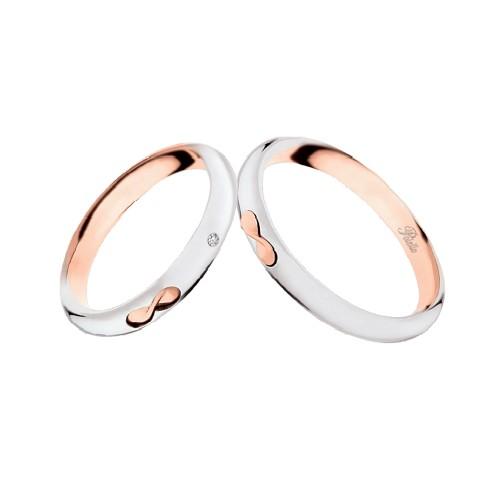 Coppia di fedi matrimoniali in oro bianco e rosa 18 Kt con diamante Polello