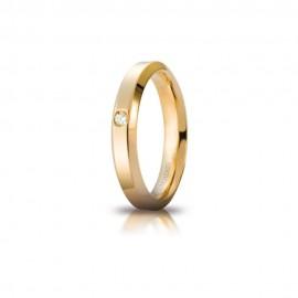 Fede Unoaerre in oro giallo, modello Hydra, con brillante da ct 0,03, lucida - larghezza fascia 4mm