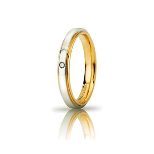 Fede Unoaerre in oro giallo e bianco, modello Cassiopea Slim, con brillante da ct 0,01, lucida larghezza fascia 3mm unisex