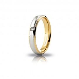 Fede Unoaerre in oro giallo e bianco, modello Cassiopea, con brillante da ct 0,03, lucida larghezza fascia 4mm unisex
